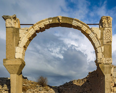 Framing the active sky (Adaptabilly) Tags: ancient shadow arch asia ephesus ephesos clouds lumixg1 ruins greek decoration architecture stone efes travel sky turkey izmir tr