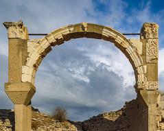 Framing the active sky (Adaptabilly) Tags: ancient shadow arch asia ephesus ephesos clouds lumixg1 ruins greek decoration architecture stone efes travel sky turkey izmir tr