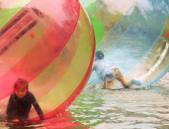 Chinese children fun at the park pond inside inflatable air bubbles, Hefei, China (Germán Vogel) Tags: asia eastasia china travel traveldestinations traveltourism tourism touristattraction landmark holidaydestination famousplace hefei anhuiprovince publicpark park child children chinesepeople girl boy bubble pond float havingfun entertainment leisure outdoor outdoors ball colorful play playing xiaoyaojinpark xiaoyaojin