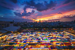 Multi-colored tents /Sales of second-hand, Train Night Market Ratchada, Bangkok, Thailand (Patrick Foto ;)) Tags: architecture area asia background bangkok building business city cityscape color colorful concept evening floating food high landmark light man market modern night noisy outdoor outside people place popular ratchada roof saduak secondhand sell shop square street sunday tent tents thailand tourism tourist trade traditional train travel twilight umbrella view woman bangkokmetropolitanregion th