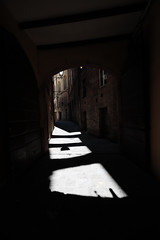 LOVE (czerwiony Smãtk) Tags: siena italy city sun light shadow building architecture lamp gate brama