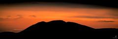 Sunset over the silhouette of a pingo (Chriskellyphotography) Tags: sunset pingo northwestterritories tuktoyaktuk telephoto split panoramic panorama silhouette