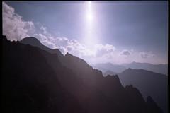 Papirusz (Čierny štít) - 2 434 m (Boldizsár Nádi) Tags: 35mmfilm 35mmcamera 35mmphotographer 35mmphotohraphy photographersontumblr originalphotography yashica t3 tessar f28 agfa 100 film filmphotography filmcamera filmgrain analogcamera analogphotography analog analogphotohrapher analogue analogvibes celluloid ridge berg steigen bergsteigen climbing mountainclimbing alpinism alpinist mountaineering ascending landscape clouds horizon valley tatry tatras hightatras vysoketatry peak sun lensflare cloudy sky magas tátra argentique