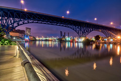 Crossing the Cuyahoga (tquist24) Tags: cleveland cuyahogariver hdr mainavenuebridge mainavenueviaduct nikon nikond5300 ohio outdoor theflats architecture bluehour bridge city fence geotagged light lights longexposure morning reflection reflections river sidewalk sky water