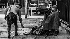 One must be poor to know the luxury of giving.~George Eliot~ (Lorrainemorris) Tags: street candid streetphotography generous lorrainemorris lightroom city dublin ireland blackandwhite monochrome sonyilce7rm2 singing kindness mood giving songs man batis zeiss sony 7rm2