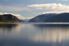 Tranquility (smir_001) Tags: august summer canoneos7d sognefjord sognefjorden thekingofthefiords largest deepest fjord norway e39 oppedallavik aven tranquillity serenity beautiful bluesky reflection water sognogfjordane mountain attraction tourism nature outdoor landscape panorama vista norway2018 longexposure 10stopper