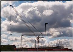 Crane and sky.   Ciel industriel et nuages (Dennis Kallmer) Tags: crane sky clouds nuages ciel