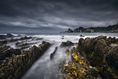 Shimmering Silvercoast (Manuel.Martin_72) Tags: gueirua cudillero asturien spain darkmood darkness drama mysterious coast rocks sand stones sea water waves cloudy clouds overcast rainy afternoon wbpa