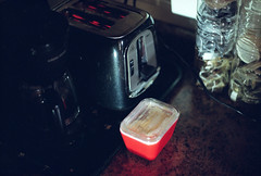 untitled (kaumpphoto) Tags: mamiya nc1000s kodak portra 800 kitchen toaster coffee tea glass tray butter dish color orange cord black glow filament heat toast lid kettle wire