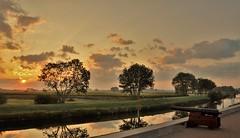 Between the clouds.....2-9-18 (wilma HW61) Tags: zonsopkomst zonlicht zon sunrise sunlight sun alba leverdusoleil sonnenaufgang solopgang bomen reflectie reflection water wasser weiland meadow apeldoornskanaal kanaal kanal ochtendstond ochtengloren ochtendzon morningglory morn sky clouds wolken wolkenlucht atmosfeer atmosphere kanon cannon view scenery scenario landschap landscape landshaft uitzicht diepte depth hattem gelderland veluwe nederland niederlande netherlands natuur nature natur naturaleza nikond90 holland holanda paysbas paesibassi paísesbajos europa europe été zomer summer sommer outdoor wilmahw61 wilmawesterhoud uiterwaarden hoenwaard illumination tree grass field htmt