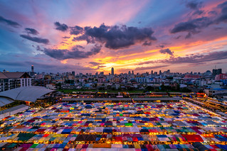 Sunset scence of Bangkok Panorama ,Aerial view of Bangkok night market in Bangkok city downtown with sunset sky and clouds at Bangkok , Thailand. And colourful tents