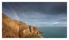 Ellin's Rainbow (Ollie Pocock) Tags: landscape wales north seascape ocean sea rocks cliff uk united kingdom rainbow showers clouds sunset light evening dusk waves