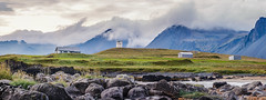 Stunning West (Alex Demich) Tags: iceland landscape panorama mountains stones grass outdoor travel adventures sky clouds houses farm evening ridge white grey green