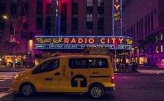 New York (KennardP) Tags: newyorkcity newyork nyc canon5dmarkiv 5dmarkiv 24mmf14lii 24lii ef24mmf14liiusm radiocitymusichall taxi yellowcab yellowcabnewyork cars building cityatnight citylights city nightlights nightphotography handheldnightphotography