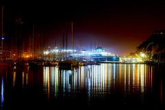 Port De Barcelona - A la nit (Fnikos) Tags: port puerto porto harbour harbor sea water waterfront sky skyline color colour architecture bridge ship boat light dark reflection night nightview nightshot outdoor