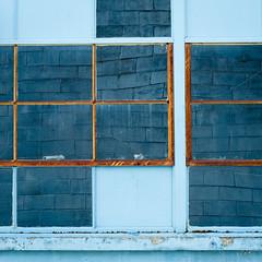 blueberry ripple (jtr27) Tags: dscf1268xl jtr27 fuji fujifilm xe2s xtrans nikon seriese 50mm f18 manualfocus ais blue window rust oxidation reflection maine newengland distortion