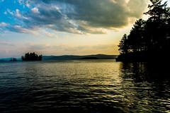 Sunset on Lake George (Davien Orion) Tags: explore yellow green blue sky water tree newyork upstatenewyork adirondacks photoshopelements logbay lake sonya77 sony beautiful flickrbest ngc lakegeorge sunset