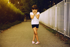 Small Girl Posing (dejankrsmanovic) Tags: girl small kid child young youth childhood sidewalk park outdoors pose people one day summer fashion cute beautiful gate fence leg body street asphalt lifestyle expression standing infrontof