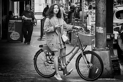 Caught Texting While Biking (Ian Sane) Tags: ian sane images caughttextingwhilebiking woman bicycle black white monochrome candid street photography downtown portland oregon corner canon eos 5ds r camera ef50mm f14 usm lens