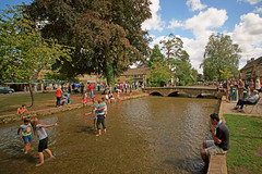 People relaxing at Bourton-on-the-Water, Cotswolds, England (Minoltakid) Tags: fun summer relaxing bourtononthewater cotswolds england day trees bridge clouds sky minoltakid theminoltakid rossdevans rossevans
