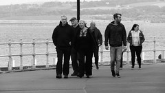 Autumn Afternoon at Portobello 025 (byronv2) Tags: sunny sunlight sunshine autumn portobello edinburgh edimbourg scotland coast coastal sea northsea firthofforth forth rnbforth river riverforth beach portobellobeach blackandwhite blackwhite bw monochrome peoplewatching candid stre