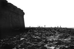 Fishing At The Lighthouse - Rabat Morocco (Modkuse) Tags: wall atlantic ocean atlanticocean fishing morocco rabat rabatmorocco monochrome bw blackandwhite contax contaxrangefinder contaxii zeisssonnar zeiss zeisscontaxrangefinder zeiss50mmf15sonnar 50mm fishermen
