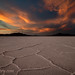 Dramatic sunset over Bonneville Salt Flats with pronounced salt crystals