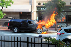 """Did someone say """"Fire"""" (Eclectic Jack) Tags: fire car auto ma boston massachusetts suburban taxi fence fenced friday black orange"""