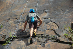 Climbers (manalbukhari) Tags: rock climbing slab man boy green blue top rope awesome nature cool orange brown shoes toes