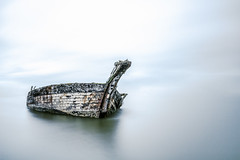 Lost wreck (The Black Fury) Tags: minimalist landscape clouds sky nature water longexposure poselongue boat wreck old blue minimal estuary white