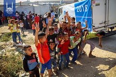 Children smile at the Islamic Relief USA Qurbani distribution in Lebanon.