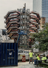 """Vessel is a 16-story structure of connected staircases between the buildings of Hudson Yards, located in the 5-acre Hudson Yards Public Square. Designed by Thomas Heatherwick,Vessel has 154 flights, 2,500 steps, and 80 landings. (nrhodesphotos(the_eye_of_the_moment)) Tags: dsc040173001084 """"theeyeofthemoment21gmailcom"""" """"wwwflickrcomphotostheeyeofthemoment"""" construction vessel hudsonyards metal reflections shadows container workers constructionworkers westside manhattan nyc crane outdoors"""