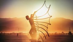 Liberation of Light (Mike Filippoff) Tags: burningman buringman2018 sculpture sunset wings silhouette light sun mountains glow dust playa