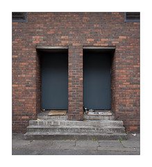 The Built Environment / Homeless Persons Shelter, East London, England. (Joseph O'Malley64) Tags: thebuiltenvironment homelessinlondon2018 newtopography newtopographics urban urbanlandscape geometric geometricshapes architecture architecturalphotography socialdocumentary documentary documentation eastlondon eastend london england uk britain british greatbritain brickwork bricksmortar cement pointing redbrick louvres vents lintels doors firedoors fireescapes woodendoors entrances exits concrete concretesteps pavement cardboard newsprint beercans aluminiumdrinkscans detritus homelesspersonspitch shelter building structure litter fujix fujix100t accuracyprecision