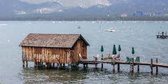 Every step of the way (A Different Perspective) Tags: california southlaketahoe usa boathouse chair jetty umbrella wall water wood