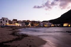 Favignana, la spiaggia dietro al porto (rafpas82) Tags: favignana sicily sicilia egadi isola island beach spiaggia spiaggetta mare sabbia alghe case luci houses light seagrass sea mediterraneo mediterraneansea sky fujifilmxt20 fujinon1855 cavalletto tripod xt20