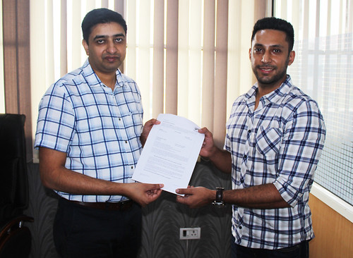 Mr. Gurvinder Kang (Director of West Highlander) handing over New Zealand Visitor Visa to Ramneek Singh Padam