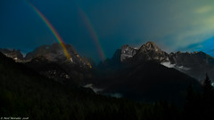 Wonderful weather. (Neil. Moralee) Tags: italyneilmoralee neilmoralee rainbow rain bow colour color sky mountain mountains hills arc treasure weather reflection refraction red violet blue dolomites italy madona di campaglio neil moralee olympus omd em5 yellow green droplet water mountainside