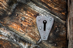 Ancient door locker (Agnolo) Tags: aged ancient antique architecture background brown building close closed closeup decoration design detail dirty door doorknob doorway entrance exterior front gate handle history home house iron key keyhole knob lock medieval metal mystery obsolete old ornament ornate pattern retro rust rusty safety security style texture traditional vintage wall wood wooden