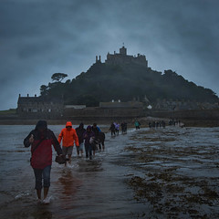 Washed Out (JDWCurtis) Tags: stmichaelsmount stmichaels mount hill people tide tidal tidalisland island nationaltrust wading waders peopleinnature nature southengland cornwall sea seafront water waterfront waves splash coats wet weather gloomy rain dark sky southwestengland history historicalmonument icon iconic