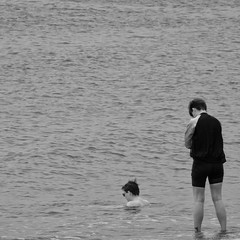 Dipping (evans.photo) Tags: people sea seaside aberystwyth monochrome square candid