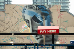 Pay Here, Pay Now...Pay Later (Roblawol) Tags: color face calgary paintedwallart buildings graffiti canon red paintedstreetart blue colorful streetart eyes wall colors canada graffitiart urban eosm50 northamerica