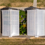 Bird's eye view of two greenhouses. Aerial photography thumbnail