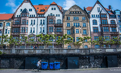 2018 - Germany - Düsseldorf - Rhine River Waterfront (Ted's photos - For Me & You) Tags: 2018 cropped düsseldorf germany nikon nikond750 nikonfx tedmcgrath tedsphotos vignetting düsseldorfgermany skateboarder dusseldorf dusseldorfgermany streetscene street streetlamp streetlight windows people peopleandpaths pathsandpeople bluebins
