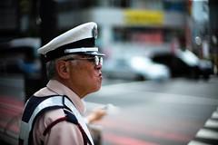 """On duty"" (jaxting) Tags: jaxting 東京 tokyo street people candid noctilux leica"