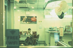 Ektachrome nightcrawlers 17: late night touchup (NYC Macroscopist) Tags: ektachrome nightcrawlers street urban streetphotography avaliablelight latenight night woman alone lonely moody atmospheric vintage vintagecolors expiredfilm leica 50mm summilux summer hot midnight city manhattan new york newyork nyc retrochrome320