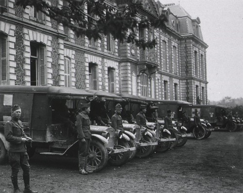 U.S. Army. Base Hospital No. 12. Bonvillers, France: Ambulances lined up prepared for an emergency call