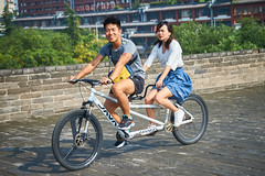 2018 Xi'an - On and Around the Old City Walls 54 (C & R Driver-Burgess) Tags: xian 西安 wall city towers ancient historical stone defense tourist couple tandem cycle pair man woman together