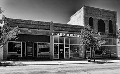 The Real McCoy (Orson Wagon) Tags: green kansas black white sign old commercial block small town city texture