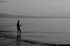 peace of mind... (gregtz) Tags: bw blackandwhite blackwhite sea seaside shilouettes fishing bridge emotions nafpaktos people calmness θάλασσα ασπρόμαυρο ψάρεμα συναισθήματα σιλουέτεσ ηρεμία ναύπακτοσ αντανάκλαση reflection